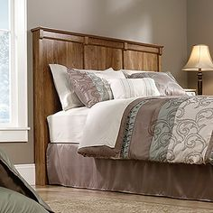 Attaches to full or queen size bed. Quick and easy assembly with patented slide-on moldings. American Chestnut finish.