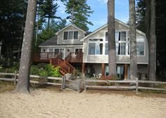 Spectacular waterfront vacation rental on lake Winnipesaukee with a sandy shared community beach, dock, game room and so much more. An absolute gem. This gorgeous waterfront home is located in one of the nicest waterfront communities on the Big Lake in New Hampshire!