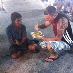 A tourist noticed a man on the street unable to feed himself. And so, he stopped to help