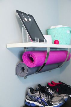 Get your mats off the ground and use extra large wall brackets as a sneaky storage space. Super easy to DIY. Great for minimalist style.