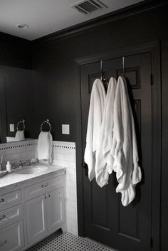 Black-and-white bathroom; the all-black walls seem a little scary, but if you had enough natural light, it would be good :)