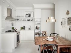 Could you wile away a morning in this lovely Swedish space? Stadshem.