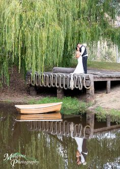 Reflection in the lake, bride and groom at a rustic Inglewood Estate wedding