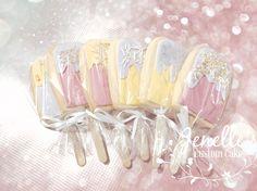 Ice cream cookie pops. By Jenelle's Custom Cakes!