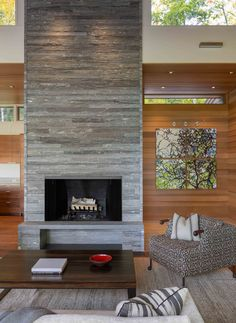 In this modern living room, there's a stacked stone fireplace and hearth, that draws the eye upwards to the clerestory windows and the height of the room. Modern Wood House, Modern House Design, Contemporary Design, Style At Home, Modern Stone Fireplace, Living Room Designs, Living Room Decor, Mountain Home Exterior, Cedar Walls