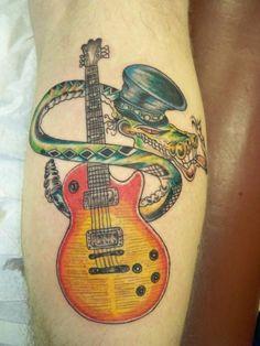 Slash as snake guitar tattoo