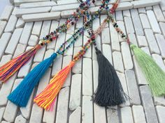 BOHO HIPPIE IBIZA NECKLACE No.9  Material: glas, wood and swarovski pearls, cotton and nylon bands  Length chain (grey, blue, green): 41 cm  Length pendants (rey, blue, green): 9,5 cm  Length chain (multicolor big & little): 38 cm  Length pendants (multicolor big & little): 9 cm  Wight (grey, blue, green): 0,015 kg  Wight (multicolor big): 0,025 kg  Wight (multicolor little):  0,015 kg