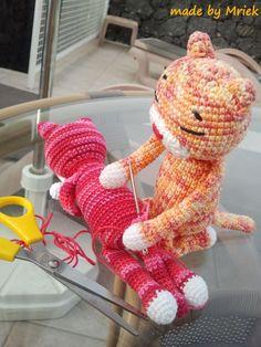 Amineko sewing a tail on Amineko