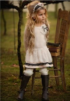 love the outfit - from the headband down to the ruffle socks sticking out of the top of the cute boots.
