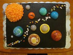 Solar system Boston Cream birthday cake with chocolate planets and buttercream covered sun