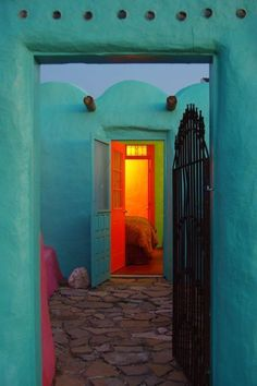 Portugal-stunning turquoise walls with red door opening to yellow, orange glow