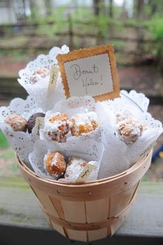 DIY Donut Holes... presented in cone-shaped paper doilies.  Cute idea...