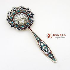American gilt sterling silver large bon bon spoon with ornate multi colored enamel decorations atop an openwork scroll body. Made by Gorham Marked Gorham Sterling, Sterling Silver, Spoons, Precious Metals, Antique Silver, Enamel, Antiques, Berry, Tattoo Ideas
