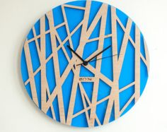 Handmade Wall Clock Tree leaves  The Inspiration for this watch was found in tree leaves : fresh spring greenery, morning freshness and natural curves.  Material - plywood and acrylic Acrylic can be differnt colours   Cladding - Oil  Mechanism - Hermle (Germany). Requires 1 AA battery (not included) Silent mechanism  Intersection of hours - acrylic Diameter: 37cm (14,57) - 79$ 40cm (15,75) - 89$ 50cm (19,7) - 119$ 60cm (23,62) - 139$ 70cm (27,5) - 159$