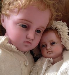 Rare Pierotti portrait boy doll caring for his younger sister.