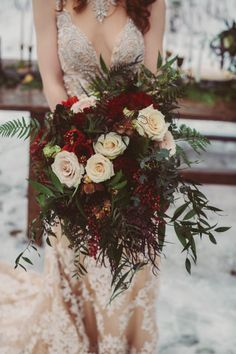 white and red wedding bouquet with ferns