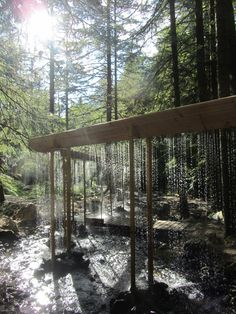 A veil of water stretches 40 metres between the trees of a wood in central France to form this installation.
