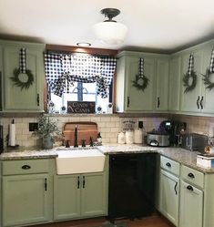 Thank you Liz from for the most adorable idea with the mini wreaths. I had leftover buffalo check ribbon and… Sage Kitchen, Green Kitchen Cabinets, Refacing Kitchen Cabinets, Painting Kitchen Cabinets, Cabinet Refacing, Blue Cabinets, Wall Cabinets, Cabinet Makeover, Primitive Kitchen