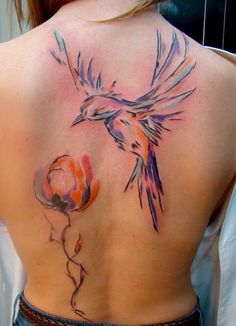 fantastic bird back watercolor tattoo with flower - stem, feather