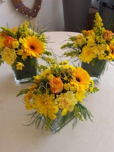Golden Wedding Anniversary - yellow and orange flower arrangements in glass cubes