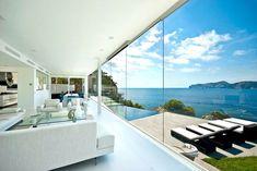 Mallorca waterfront designer villa for sale Would Buying This Glazed Waterfront Designer Villa Make You Happier?