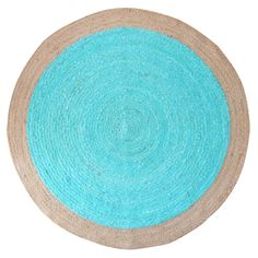 Moonshine Rug – Turquoise   Not only is this rug utterly gorgeous but it has a conscience. At RAW Sunshine Coast, ethically sourced and environmentally friendly pieces are very important. Designed by us, we've had the 'Moonshine' rug hand woven in Agra, India by a talented team of artisans. Each rug is made from a combination of recycled cotton saris and jute, a sustainable natural fibre.