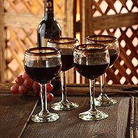 Blown glass wine glasses, 'Amber Globe' (set of 4) - Fair Trade Handblown Glass Recycled Wine Glasses Set of 4