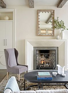 A simple, clean-lined mantel reflects the room's calm atmosphere. - Photo: Emily Jenkins Followill / Design: Beth Webb