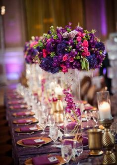 Tall lush purple floral centerpiece by The Wildflower. Photo by Sil Azevedo Photography #wedding #floral #centerpiece #purple