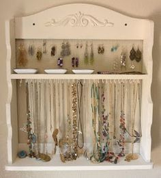 DIY Jewelry holder from goodwill spice rack- works a little better than the frame jewelry holder.