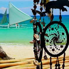 i absolutely l<3ve dream catchers. usually they are adorned with feathers and beads, but these are so unique with buttons and sea shells, and they are such a fun project. send the kids out to the beach to find some pretty sea shells, and search for that huge tub of spare buttons that you have collected over the years. done and done! ☮ariel