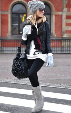 Perfect outfit for a cold day! Cozy boots, hat, mittens, and a big oversized sweater. Adding a leather jacket and bag give the outfit a more put-together look while still looking relaxed and casual. Super cute for grabbing coffee with a friend!
