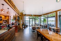 :: PODIUM CAFE :: 'Podium Cafe' - Karapiro Lakeside rustic cafe in Cambridge, NZ. Rustic wall panelling & detailing create a warm & inviting dining space. World class rowing venue. Rustic Cafe, Wall Panelling, Commercial Architecture, Rustic Walls, Rowing, Cambridge, Warm, Space, Create