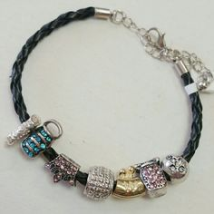 Black charm bracelet Black charm bracelet| with gold tone and silver charms|| length 8 inch with extra 3 inch of extender perfect condition| no trades boutique  Jewelry Bracelets