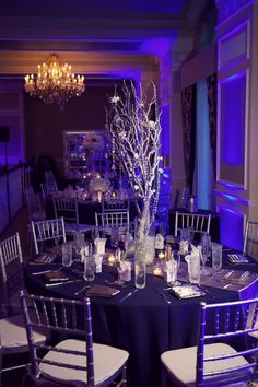 White & Silver Branch Wedding Centerpiece with Blue Uplighting - Navy Blue, Silver & White St. Pete Beach Wedding - Don CeSar - St. Petersburg, FL Wedding Photographer Reign 7 Studios