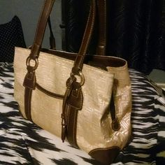 Liz Claiborne Nice purse that goes with just about anything! Has some signs of wear mainly the inside (balling) & a spot of pink ink.  look at pics closely.  In the third pic on that gold medal piece there are scratches but I always liked to wear that side against me as the other side seemed more like the front. Liz Claiborne Bags Shoulder Bags
