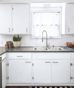 Cracked, dated Formica counters were swapped out for plywood and dressed up with a coating of concrete—a project that entails sanding, mixing and spreading the concrete, more sanding once the layers dry, and adding a sealer.