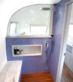 Luna Blue Moon Trailer Airstream Bathroom shower wood floor tile walls window sing counters shampoo Plus Airstream Remodel, Airstream Renovation, Travel Trailer Remodel, Airstream Interior, Vintage Airstream, Travel Trailers, Vintage Campers, Vintage Trailers, Camper Trailers