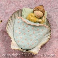 wee shell bed. So many intricate dolls. She is a master at embroidery!