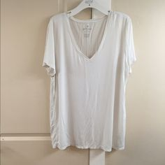 Soft & Sexy Comfy T This shirt is seriously so comfortable. It hangs really nicely. It looks adorable on and is the ideal white v neck T. American Eagle Outfitters Tops Tees - Short Sleeve