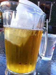 Put a cup of ice in a pitcher of beer to keep it cool