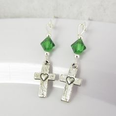 You waana see these earrings https://www.etsy.com/listing/202810472/rustic-cross-earrings-cross-jewelry