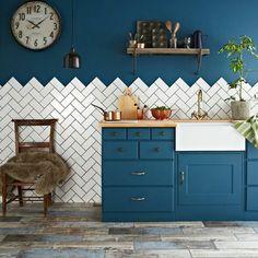 Metro tiles in a herringbone pattern on the kitchen walls