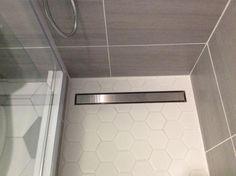 Daltile Nova Falls Gray 12 in. x 24 in. Porcelain Floor and Wall Tile sq. / case) at The Home Depot - Mobile Bathroom Layout, Small Bathroom, Master Bathroom, Bathroom Lighting Design, Bathroom Interior Design, Shower Drain, Shower Floor, Toilet Tiles Design, Floor Drains