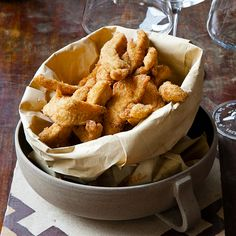Chicken fingers for grown-ups: thin strips of chicken are marinated in ale and citrus juices, then fried until crispy and golden.
