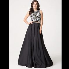 Gorgeous black two piece gown with embellished top Two piece gown from bebe. Perfect for prom or wedding or the red carpet. Embellished top is beautiful and skirt has tulle which can be taken out depending on preference. bebe Dresses Prom
