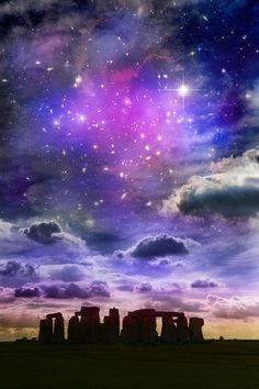 Purple galaxy full of stars with purple blue milky way above Stonehenge England…