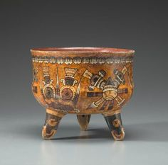Aztec, Eastern Nahua, Polychrome Tripod Vessel, ca. A.D. 1470-1521 height 6 1/2in (16.5cm) Finely painted with alternating clusters of bloodletting instruments together with crossed arrows emblematic of the Eastern Nahua patron god Mixcoatl meaning Cloud Serpent. Balls of eagle down surround the rim while the vessel's feet are ornamented with eagle heads.