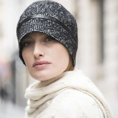 A chevron hat with a leather band on the rim. The model combines the classic and timeless charm of the chevron with the originality of its shape for a chic and Parisian look.  96% New wool, 4% Polyamide