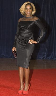 J is for jolt: Mary J. Blige injects some foot-forward fun into her black Catherine Malandrino dress at the White House Correspondents' Dinner.